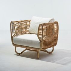 The Cane line Nest Club Chair is made of sustainable natural rattan and is part of the indoor furniture collection by Cane-line, suitable for a Sunroom or Conservatory. Cushion set included.