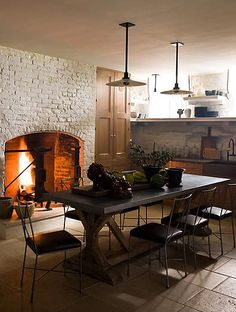 exposed brick fireplace in the kitchen/dinging Mix and Chic: Cool designer alert- Steven Gambrel!