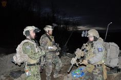 SEAL standing with some MARSOC Operators