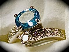 Simulated Ceylon Sapphire(oval 3.16ct.) Simulated Diamond Ring in Silver-tone Size 8 TGW 3.64 cts.      $50.00