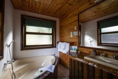 Bathroom at Tsitsikamma Lodge & Spa. Allure Spa, River Lodge, Storms, Corner Bathtub, Lodges, Cabin, Bathroom, Building, Design
