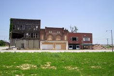 Series of abandoned buildings in downtown Cairo, Illinois via MuZemike