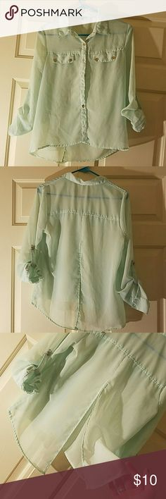 Charlotte Russe shirt The shirt is a light teal, mint green color. It is mid sleeved and buttons at the sleeve. It is a high low shirt. Higher in the front longer in the back. And also has a split in the back. Worn a couple times but nothing wrong with it. Charlotte Russe Tops