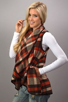 These plaid vests are so perfect to throw on and go! They are an absolute must have for Fall and Winter! This vest features a waterfall style, open front, & faux leather piping with side pockets. Smal