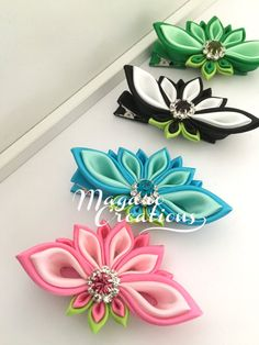These beautiful custom-made kanzashi hair clips would be perfect for you or your little girl and would make a wonderful gift. I created these adorable hair clips by using the kanzashi method. Satin ribbon is delicately folded to create these beautiful flowers which measure approximately 3 across. The flower is attached to a 2.25 alligator hair clip with. The flower ribbons have treated ends to prevent fraying. This listing is for 1 kanzashi hair clip in your color choice: HOT PINK/LT. PI...