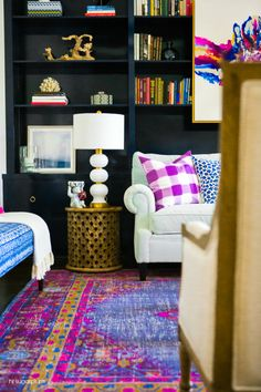 Bright pink and blue living room design with warm brass accents.