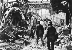German troops pass through a wrecked generating station in the factory district of Stalingrad, on December 28, 1942. (AP Photo)