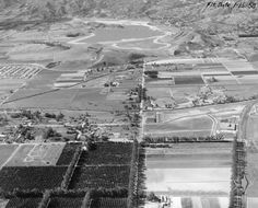 Aerial view looking west on Nordhoff Street toward its intersection with Topanga Canyon Boulevard. The Southern Pacific tracks are on the right. The Chatsworth Reservoir, filled with water, is seen in the background. Southern California, Topanga Canyon, San Luis Obispo County, San Fernando Valley, California History, Aerial View, Paris Skyline, Scenery, Paisajes