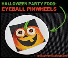 Eyeball Pinwheels -- easy Halloween party food: tortillas rolled up with black olives & roasted red peppers to give the look of bloodshot eyeballs for your next Halloween Party.