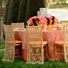 Another beautiful but delicate gold and coral wedding table design!