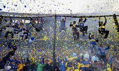 Kicking off: Boca Juniors fans at La Bombonera stadium in Buenos Aires