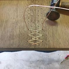 I love when someone mixes materials in a new way! Kevin Manville is REALLY stitching slabs together with copper wire.