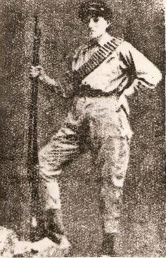 Aguline Tatoulian, during the Armenian Genocide, she shaved off her hair and dressed herself up in men's fatigues in order to protect herself and defend her city of 35,000, which was being raped and pillaged by the Turks. She was shot in her left rib and lived with that bullet for 67 years. She was 1 of 9 women who survived the massacres Hadjin town, Adana Province in 1918...