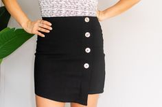 #BOSSIN all day long, looking fresh and fabulous in our Black Mini skirt. Stretchy material was chosen to ensure 100% comfort and a fitted style. Hustle all day and Evolve into a badass at night!    Model wears size small  Product Description:  Back zip Faux button down Asymmetric Extra stretch black fabric Synthetic Boss Babe, Black Fabric, Stretchy Material, Hustle, Badass, High Waisted Skirt, Mini Skirts, Product Description, Fresh