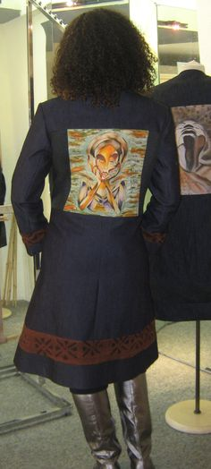 Model wearing a denim art jacket with the canvas print, 'She Moves' featured on the back. Each denim art jacket is unique and creative. #denimart, #poeticart