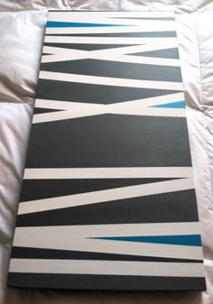 First DIY project done. $30: 15x30 canvas, grey & teal acrylic paint, painter's tape. New idea for some art work in my house!!