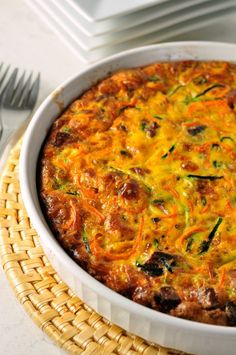 Paleo Zucchini-Carrot Quiche. A crustless quiche full of healthy vegetables and flavoured with bacon. www.flavourandsavour.com
