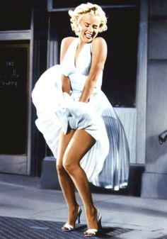 The Seven Year Itch:    This infamous shot of Marilyn Monroe's halterneck white dress blowing up around her legs as she stands over a subway grating was originally shot on Manhattan's Lexington Avenue. Onlookers whistled and cheered through take after take as Marilyn repeatedly missed her lines - and eventually the scene had to be reshot in a studio.    FACT: The dress recently sold at auction for $4.6 million.