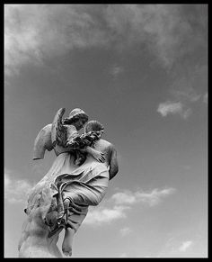 A Heavenly Escort...this is so comforting and beautiful to me.  (St. Joseph's Cemetery, Cincinnati)