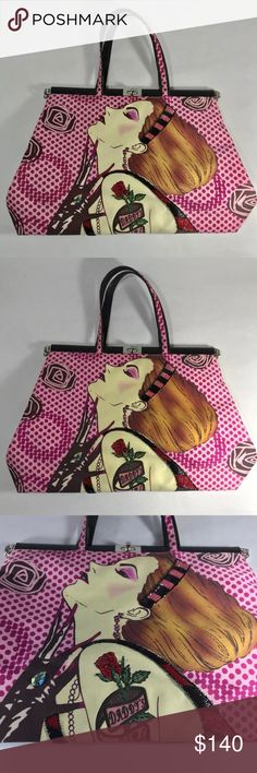 """Isabella Foote daddy's girl tattoo handbag tote Authentic Isabella Fiore Handbag Fabric with leather trim The design is of a pretty woman with """"daddy's girl rose tattoo"""" Embellished with beads and crystals on front side Same design  on back  Pocket inside that zips shut.  16"""" x 10"""" x 3.5"""" at widest parts Strap drop is 6""""  CONDITION: at the lower portion of her arms there are a few light stains. Very light I did not try to clean as I was afraid of making it worse.  The rest of the bag is in…"""