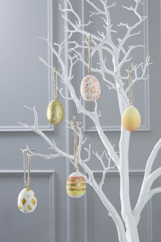 Decorate your home this Easter with these beautiful DIY painted Easter eggs, perfect for hanging on your white tree.