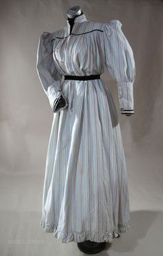Grand 1890's Striped Cotton Day Dress / Wrapper With Gigot Sleeves, in heavy blue, red, black and white striped cotton with black velvet and lace trim.
