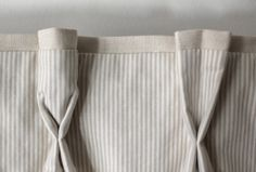 insert heavy paper loops in curtain pleats to create the fuller goblet shape on the left