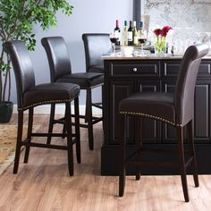 Featuring a faux leather seat and a reliable hardwood frame, the Bar Stool lends easy elegance to your countertop.