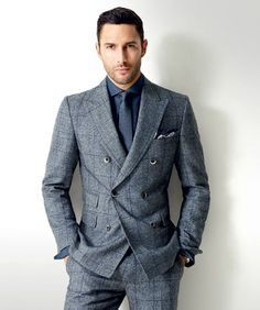 . Double breasted grey suit, dark navy shirt and tie.