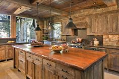 Rustic kitchen..nice but TOO MUCH WOOD Change out island with another material
