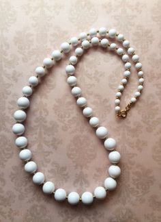 Long white and gold beaded necklace on Etsy, $25.00