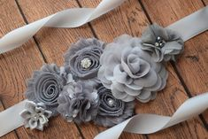This is beautiful grey Flowers Sash Belt, the sash make from satin ribbon trim wide 1 inch. The sash ribbon will be totally 3 yards long. The flowers will be about 9 inches long.   Great for dress, flower girls dress, maternity photo shoot Make from shabby flowers, satin flowers with rhinestone on central    from non smoking environment and free pet  Wash hand and lay flat to dry Any question please convo or e- mail me a message   Thank you