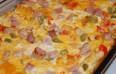 Western Omelette Caserole  1/2 – 2/3 loaf of French or Italian bread  about 1/8 cup finely diced onion  1/2 red pepper, chopped  1/2 green pepper, chopped  1-2 cups diced ham  1 cup shredded cheddar  10 eggs  2 cups milk  1 tsp. dry mustard  salt and pepper, to taste