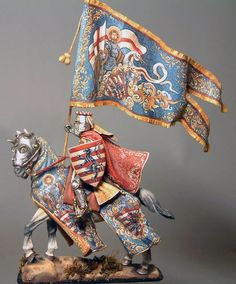 Amazing heraldry and freehand painting on this miniature knight. Not sure of the…