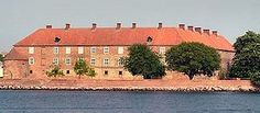 Sønderborg Castle (Danish: Sønderborg Slot) is located in the town of Sønderborg, Denmark on the island of Als in South Jutland. It houses a museum focusing on the history and culture of the area. The castle is located in the middle of the town, in a park setting overlooking Als Fjord. The museum is open year round.