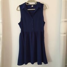 H&M blue collared dress sz10 NWOT never been worn. buttons in front and a collar. zips  on side. super cute and comfy. very flattering. perfect for summer. H&M Dresses