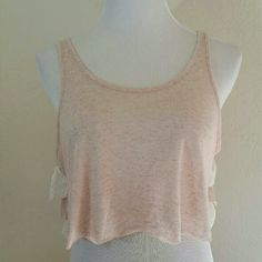FP Crop Tank w/ Lace Ruffled Back FP Crop Tank w/ Ruffled lace Back. The ruffle in between the lace has a gold shimmer to it. Oversized. Dusty Rose color. EUC.  No Trade or PP  Offers Considered  Bundle discounts Free People Tops Tank Tops