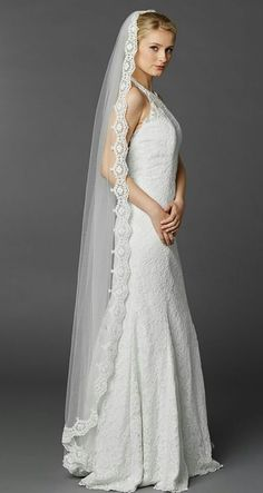 This Dramatic Floor Length Mantilla Wedding Veil Makes A Bold Bridal Fashion Statement Featuring Fully Scalloped Embroidered Lace Border