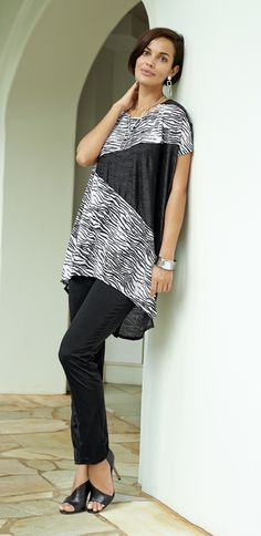Add just the right amount of wild style with this zebra-print top.