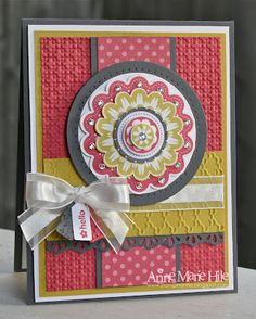 Gorgeous card by Stampin' Anne.  The main image was punched (...and ...and punched) from the Quint-Essential Flower image. I love stamps that coordinate with punches and this one happens to match up with 5 punches. Pretty fabulous, right? I also used a cool new tool called the Essentials Paper-Piercing Pack, to add those paper-pierced elements around the circle.  A+A+A+A+A+ from me to Anne!!!