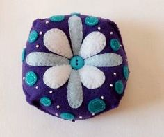 Hand Embroidered Felt Pin Cushion in Dark Purple with White and Light Blue Flower and Turquoise Blue Dots