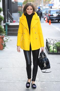 yellow coat with all black outfit