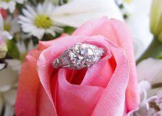 Gorgeous 1.54 carat Old European cut diamond set in a beautiful platinum and diamond detail mounting.