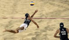 Sean Rosenthal (L) dives for the ball next to teammate Jake Gibb during the men's beach volleyball preliminary phase Pool D match vs. South Africa.