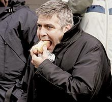 George Clooney eating a hot dog