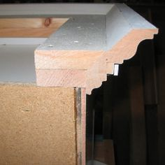 Crown molding atop kitchen cabinets.