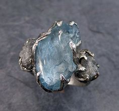 Uncut aquamarine and diamond ring, set in white gold, byAngeline.
