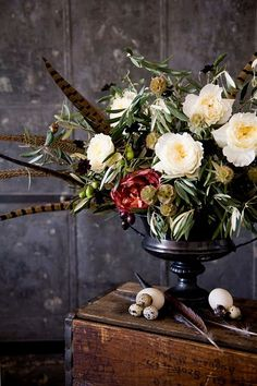 fall centerpiece inspiration -- use filler so that flowers are not distorted by proximetry