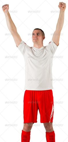 Excited football player cheering on white background ...  20s, activity, attractive, caucasian, cheering, cut out, euphoria, excited, football, gear, handsome, isolated, male, man, player, red, soccer, sport, sportsman, sportswear, white, win, winner, winning, young adult