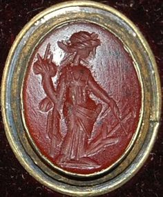 Sard gem engraved with a draped Fortuna wearing a fillet, holding a cornucopia and a steering-oar.